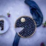 Flatly of hazelnut blueberry tart in the tin