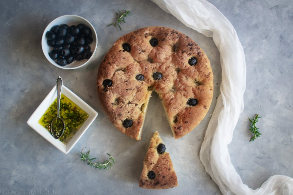 a whole loaf of olive rosemary focaccia bread