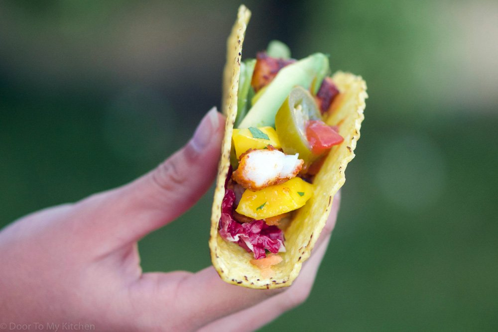 easy healthy fish tacos held in a hand