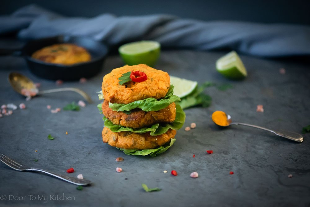 A stack of salmon and sweet potato cakes topped with chilli and coriander