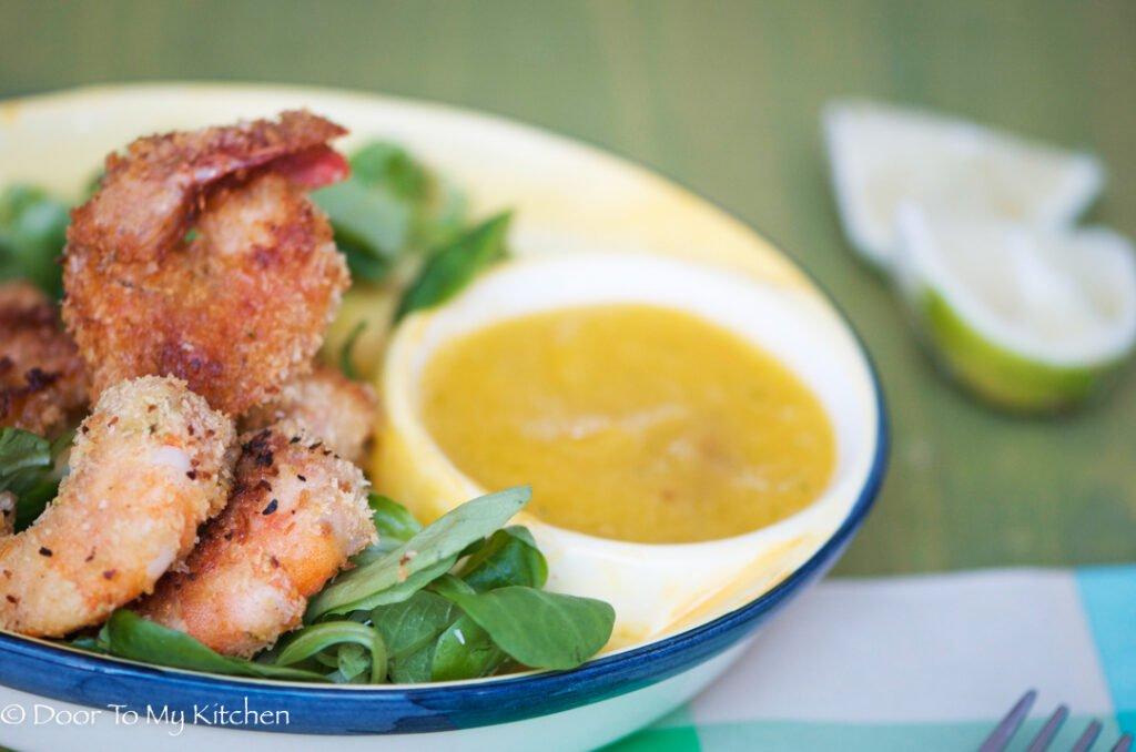 Macro shot of Caribbean prawns with mango dip