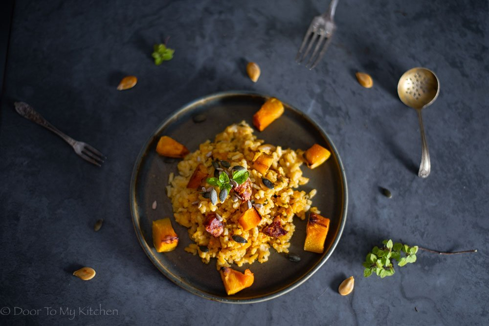 A flatly of a plate of roasted pumpkin and chorizo risotto