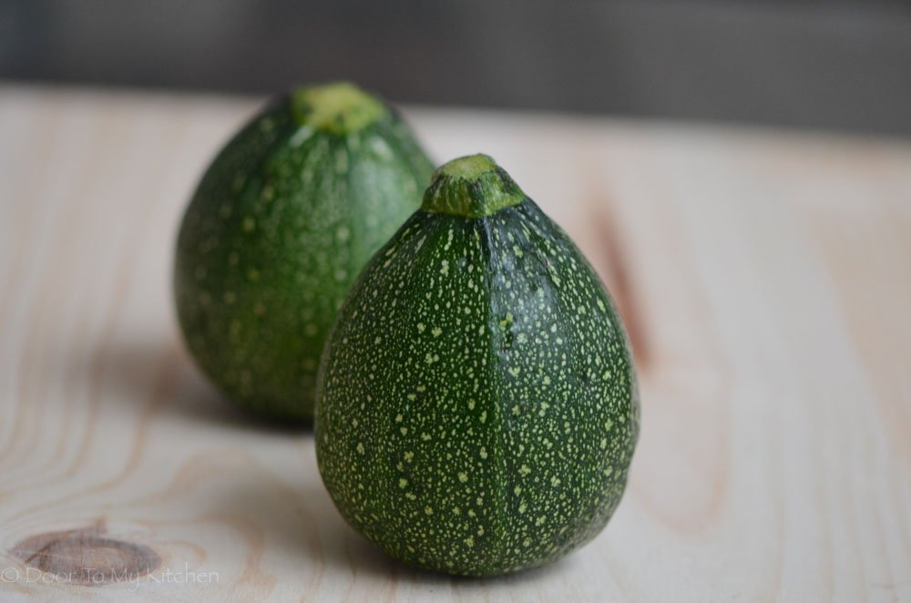 A picture of whole round courgettes before being cooked