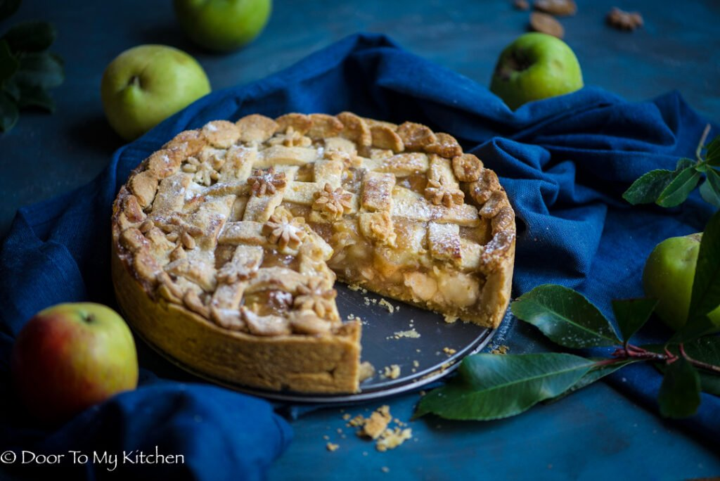 Close up of an entire apple pie with a piece missing