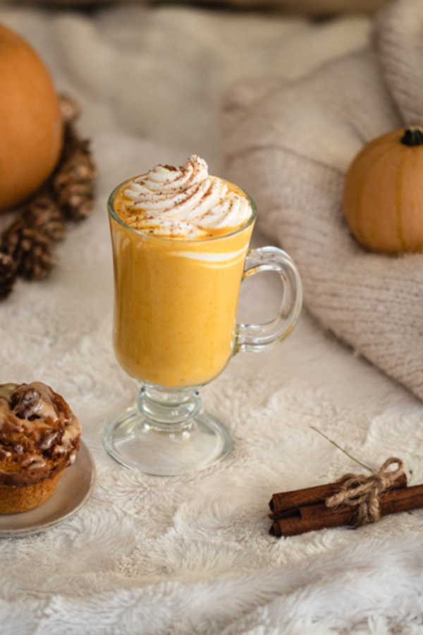 close up of pumpkin spice latte on a fluffy blanket